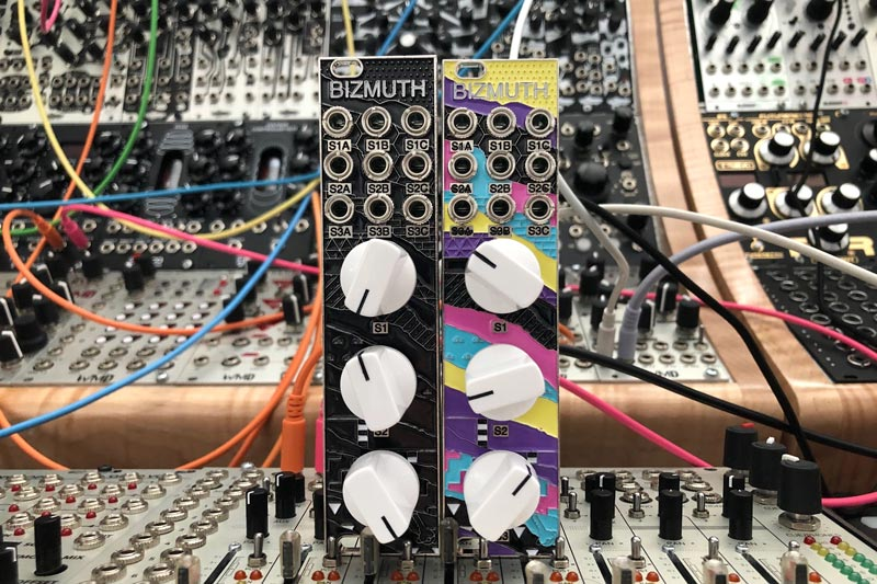 Black and classic colorful Bizmuth modules side by side.